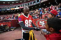 SAN FRANCISCO, CA - JULY 12:  Former San Francisco 49ers great Jerry Rice signs autographs during the Legends of Candlestick flag football game at Candlestick Park in San Francisco, California on July 12, 2014. Photo by Brad Mangin