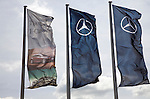 Mercedes Benz flags flying on flag poles, car sales dealership, Ransomes Europark, Ipswich, Suffolk, England