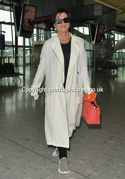 NON EXCLUSIVE PICTURE: PALACE LEE / MATRIXPICTURES.CO.UK<br /> PLEASE CREDIT ALL USES<br /> <br /> WORLD RIGHTS<br /> <br /> American model and reality television personality Kendall Jenner and her mother, Kris Jenner are pictured as they arrive at London Heathrow Airport. <br /> <br /> The pair were seen leaving The London Edition hotel an hour and a half late, after Kris got stuck in a lift on the seventh floor and had to wait for security to get her out. <br />  <br /> JULY 14th 2015<br /> <br /> REF: LTN 152212