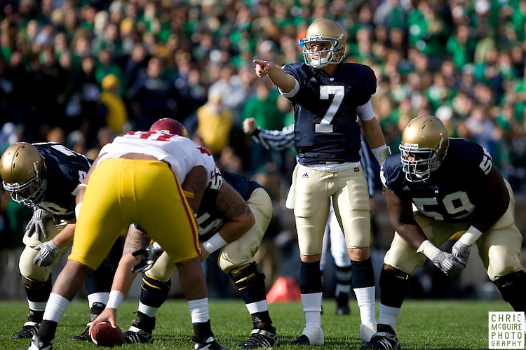 10/17/09 - South Bend, IN:  Notre Dame quarterback Jimmy Clausen checks out the USC defense in the first quarter at Notre Dame Stadium on Saturday.  USC won the game 34-27 to extend its win streak over Notre Dame to 8 games.  Photo by Christopher McGuire.
