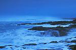 Storm surf hitting rocky coastline at dusk; Yachats Wayside State Park, Oregon.