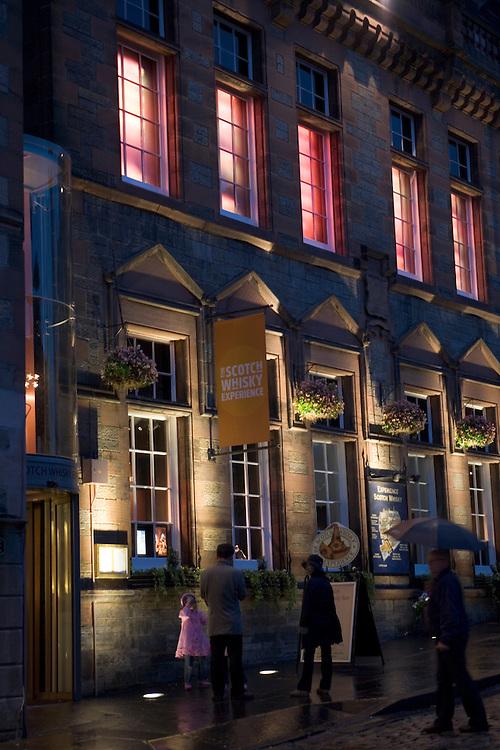 Store fronts at night below Castle- Edinburgh, Scotland.