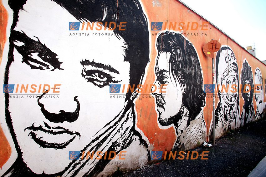 Title Wall of Fame, Artist  JB Rock, shown Elvis Presley, Yuri Gagarin, Jimi Hendrix<br /> This is a 60 meters mural showing famous faces like the Hall of Fame<br /> Rome February 7th 2019. Street Art in Rome, Ostiense<br /> district. Very important writers painted Murales in various districts of Rome to tell stories about the city, to commemorate important moments, to embellish the quarter or simply to portray it.  <br /> Photo Samantha Zucchi Insidefoto
