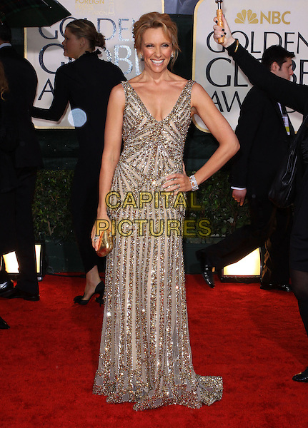 TONI COLLETTE .67th Golden Globe Awards held Beverly Hilton, Beverly Hills, California.17th January 2010..arrivals globes full length gold beaded long maxi dress hand on hip gown sleeveless box clutch bag bracelet .CAP/ADM/KB.©Kevan Brooks/Admedia/Capital Pictures