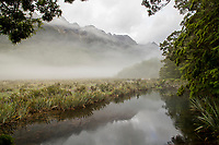 Landscape with view of Lake Wakatipu and mountains in a fog, near Queenstown, South Island, New Zealand