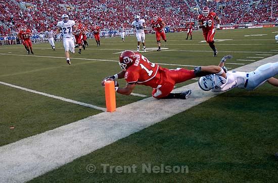 Air Force's Aaron Reyes tries to hold Utah's Quinton Ganther from the end zone. Officials ruled the ball down on the 1 yard line, where Utah scored from on a subsequent (the next?) play. Utah vs. Air Force, college football Thursday night at Rice-Eccles Stadium.<br />