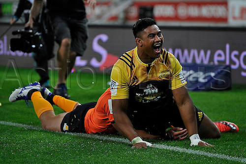 09.04.2016. Wellington, New Zealand.  Julian Savea of the Hurricanes celebrates as he scores a try with Jaguares' Mat?as Orlando during the Hurricanes versus Jaguares Super Rugby match at the Westpac Stadium in Wellington on Saturday 9thApril 2016.