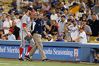 Bryce Harper #34 of the Washington Nationals bleeds from the head while returning to the dugout with Nationals trainer Lee Kuntz after colliding with the right field wall during a game against the Los Angeles Dodgers at Dodger Stadium on May 13, 2013 in Los Angeles, California. (Larry Goren/Four Seam Images)