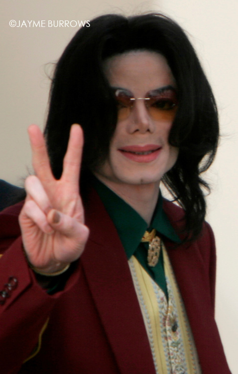 Michael Jackson enters the courtroom for the 14th day of his child molestation trial in Santa Maria, Calif on Thursday, March 17, 2005.  ..