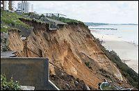 BNPS.co.uk (01202)558833<br /> Pic: BNPS<br /> <br /> The scene of a huge landslip on the same cliffs further along the coast in Bournemouth in 2016.<br /> <br /> Plans have been unveiled for 28 eco-friendly beach huts to be built into a fragile seaside cliff to protect it from erosion.<br /> <br /> The timber-clad 'pods' will be erected on two tiers hallway up the 80ft sloping seaside cliff near to Sandbanks in Poole, Dorset.<br /> <br /> The stilts will act as pile foundations and be drilled into the ground to improve the stability of the cliff.<br /> <br /> Each beach hut will have its own balcony overlooking the sea and 140sq ft of floor space.<br /> Plans have been submitted to the local council to approve.