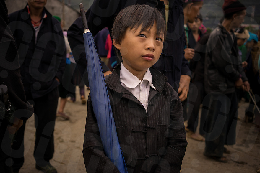 September 21, 2014 - Meo Vac (Vietnam). A kid is dressed up for the weekly market of Meo Vac. Each Sunday hundreds of people flock into town from the surrounding valleys walking for kilometers to sell and buy local products. © Thomas Cristofoletti / Ruom