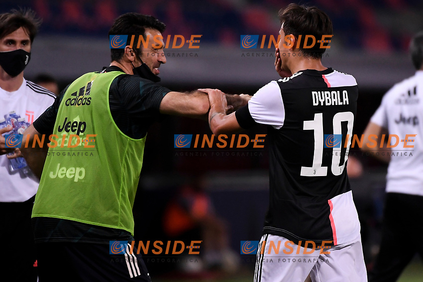 Paulo Dybala of Juventus (R) celebrates with Gianluigi Buffon after scoring the goal of 0-2 during the Serie A football match between Bologna FC and Juventus at Dall'Ara stadium in Bologna ( Italy ), June 22th, 2020. Play resumes behind closed doors following the outbreak of the coronavirus disease. <br /> Photo Federico Tardito / Insidefoto