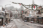 Sutter Creek's Main Street with a covering of snow and Christmas decorations on a snowy morning, Calif.