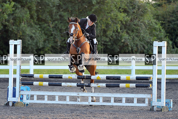 Class 3. Wednesday night showjumping. Norton Heath Equestrian Centre. Essex. 06/08/2014. MANDATORY Credit Ellie Ingram/Sportinpictures - NO UNAUTHORISED USE - 07837 394578