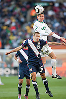 The USA's Steve Cherundolo fights for a loose ball with Slovenia's Andraz Kirm (17)  during the first half of the 2010 World Cup match between USA and Slovenia at Ellis Park Stadium in Johannesburg, South Africa on Friday, June 18, 2010.  The USA tied Slovenia 2-2.