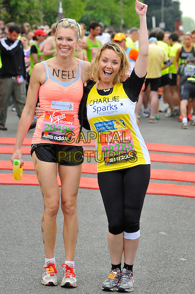 NELL McANDREW & CHARLIE BROOKS.Virgin London Marathon, Blackheath, London, England..April 17th, 2011.full length pink coral sleeveless vest top sneakers trainers yellow spandex black shorts mouth open hand arm in air cheering.CAP/CAS.©Bob Cass/Capital Pictures.