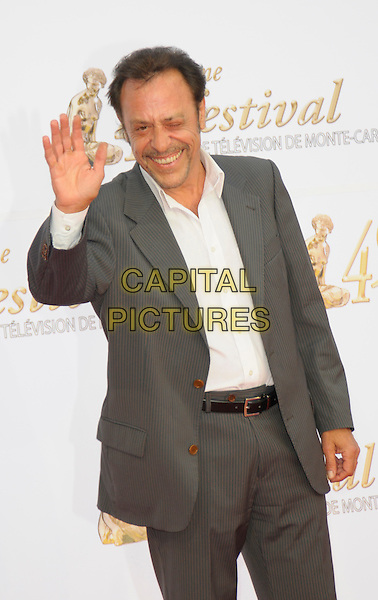 ANTOINE COESENS.Opening night of the 49th Monte Carlo Television Festival at the Grimaldi Forum, Monte Carlo, Monaco..June 7th, 2009.half length grey gray black suit jacket white top winking eye closed hand palm waving .CAP/RD.©Richard Dean/Capital Pictures.