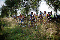 Chaos rules as the race is neutralised for the first time today. Some riders try to make advantage by getting to the front via the bushes, whilst others try to get info from the race officials.<br /> <br /> 90th Schaal Sels 2015