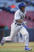 Leo Rodriguez #14 of the Rancho Cucamonga Quakes runs to first base during a game against the High Desert Mavericks at Stater Bros. Stadium on April 24, 2014 in Adelanto, California. Rancho Cucamonga defeated High Desert, 7-5. (Larry Goren/Four Seam Images)