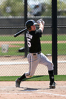 Kyle Shelton #15 of the Chicago White Sox hits a homerun in a minor league spring training game against the Cleveland Indians at the White Sox complex on March 24, 2011 in Glendale, Arizona. .Photo by:  Bill Mitchell/Four Seam Images.