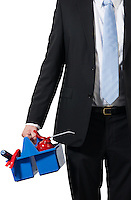 businessman ready for a workshop and carrying his tools to be successfull