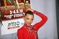 "Melitina Staniouta of Belarus smiles to cameras at ""kiss & cry"" during event finals at 2010 Holon Grand Prix at Holon, Israel on September 4, 2010.  (Photo by Tom Theobald)."