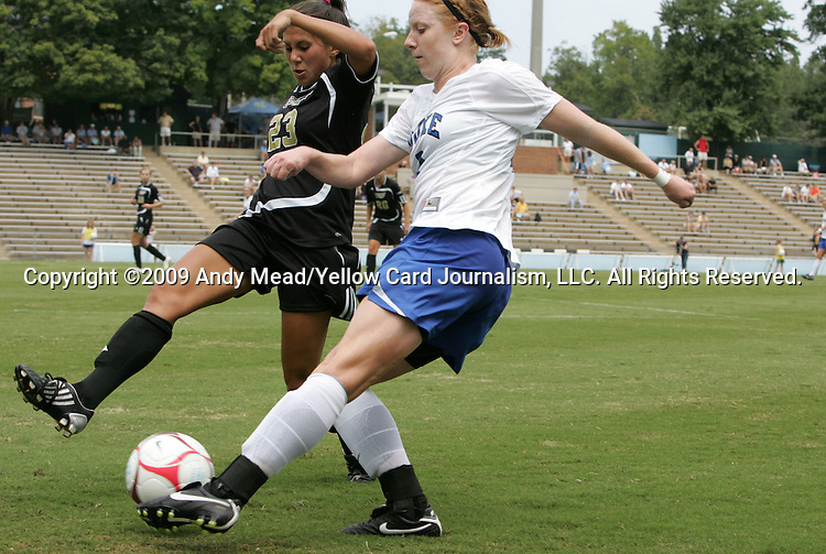 28 August 2009: Duke's Rebecca Allen (right) is defended by Central Florida's Nicolette Rodovcic (23). The Duke University Blue Devils lost 3-2 to the University of Central Florida Knights at Fetzer Field in Chapel Hill, North Carolina in an NCAA Division I Women's college soccer game.