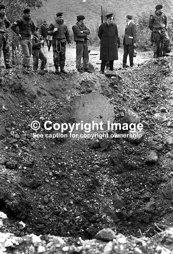 Job well done! British army sappers inspect the crater they have created on a border roard between Co Armagh in N Ireland and Co Monaghan in the Rep of Ireland. The cratering was a measure taken to hamper Provisional IRA gun and bomb attacks. 13th October 1971. 197110130427a<br />