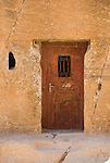 """Painted Door"" - A door shows signs of wear, on the path into the Nabatean capital at Petra, Jordan.  © Rick Collier"