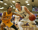 SIOUX FALLS, SD - DECEMBER 7: Drew Guebert #23 from the University of Sioux Falls drives against Lee Higgins #5 from Concordia St. Paul during their game Friday night at the Stewart Center in Sioux Falls, SD. (Photo by Dave Eggen/Inertia)