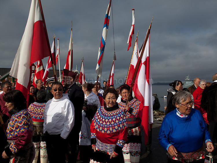 Unuit people wearing traditional dress at the Colonial Harbour, Nuuk. National Day, celebrating Self Governance, Nuuk, Greenland. From June 21 2009, Greenland moves from being under 'home rule' to 'self-governance' in a ceremony attended by the Danish Royal family and other heads of state.