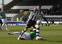 Steven Thompson controls under pressure from Pa Kujabi in the St Mirren v Hibernian Clydesdale Bank Scottish Premier League match played at St Mirren Park, Paisley on 29.4.12.