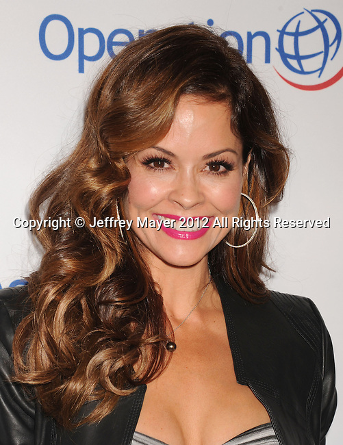BEVERLY HILLS, CA - SEPTEMBER 28: Brooke Burke-Charvet attends Operation Smile's 30th Anniversary Smile Gala - Arrivals at The Beverly Hilton Hotel on September 28, 2012 in Beverly Hills, California.