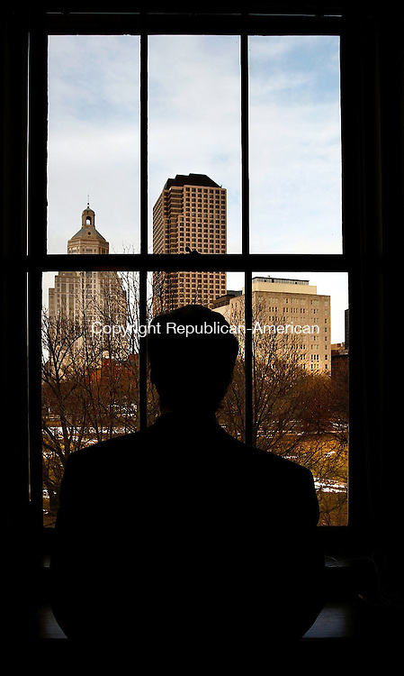 Hartford, CT- 31 January 2014-013114CM05-  Daniel C. Esty Commissioner of the Connecticut Department of Energy and Environmental Protection (DEEP) looks out into the City of Hartford from his office Friday afternoon. Esty will be stepping down from the States position and will be returning to Yale, where he is a professor.   Christopher Massa Republican-American