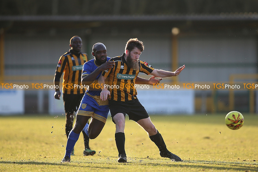 Greg Akpele of Romford is challenged by Luke Illsley of Cheshunt during Romford vs Cheshunt, Ryman League Division 1 North Football at Ship Lane on 28th January 2017