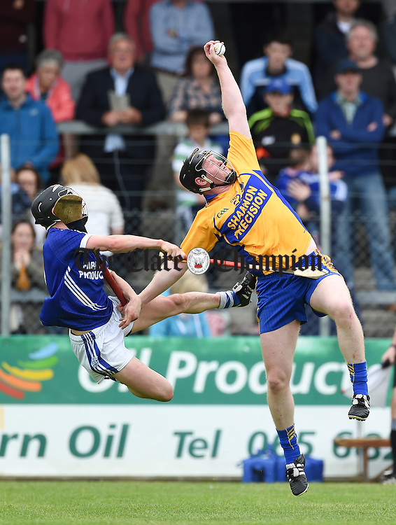 Sean Chaplin of Cratloe in action against Jamie Shanahan of Sixmilebridge during their game in Cusack Park. Photograph by John Kelly.