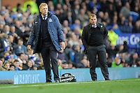 28.10.2012 Liverpool, England. David Moyes and Brenden Rogers look on during the Premier League game between Everton and Liverpool  from Goodison Park ,Liverpool