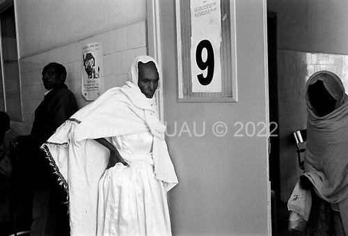 Asmara, Eritrea.November 2002.Birhan Aim Hospital (Light to the Eye Hospital)..The cataract blind wait outside the office of Dr. Desbele Ghebreghergis to be checked for possible surgery. Some have to be lead in by his assistant.