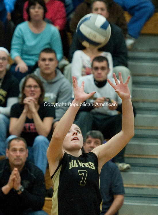 BEACON FALLS- 110613JS10- Woodland's Hannah Deegan  (7) sets the ball during their game against East Catholic Wednesday at Woodland Regional High School in Beacon Falls. <br /> Jim Shannon Republican-American
