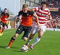 Dundee Utd's Chris Erskine gets away from Hamilton's Stephen Hendrie.