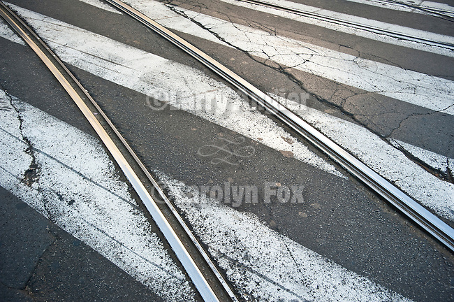 Trolley tracks and coss walk stripes juxtaposed on the street, Belgrade, Serbia.