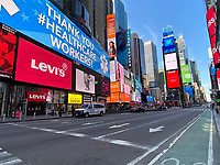 "New York, New York City. New Yorkers are told to stay home during the corona virus, (COVID-19) so New York has become eerily empty.  Times Square is devoid of its usual crowds. ""Thank you to our healthcare workers"" sign."