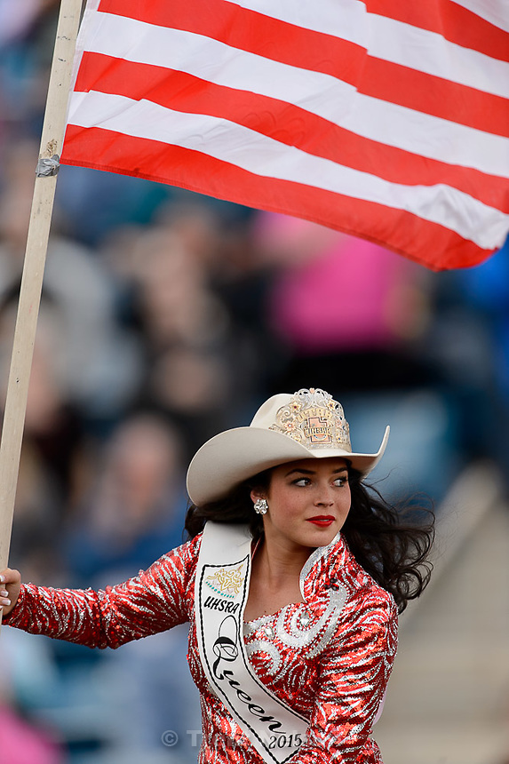 Trent Nelson  |  The Salt Lake Tribune<br /> Utah High School Rodeo Queen Baylee LaFleur rides in with the flag at the Utah High School Rodeo Association state championships in Heber, Saturday June 6, 2015.