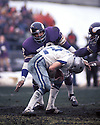 Minnesota Vikings Jim Marshall (70) tackles Roger Staubach (12) during the NFC Division Playoff game against the Dallas Cowboys on December 28, 1975. The Cowboys beat the Vikings 17-14.  The Redskins beat the Bills 41-14.  Jim Marshall played for 19 years with 2 different teams, was a 2-time Pro Bowler.