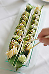 A diner takes a piece of a Caterpillar Roll, made with freshwater eel and sea eel, and japanese omelette at Sushi Sasa restaurant in Denver on March 6, 2007.  dining guide. (ELLEN JASKOL/ROCKY MOUNTAIN NEWS).***