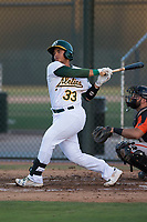 AZL Athletics catcher Jorge Gordon (33) follows through on his swing during an Arizona League game against the AZL Giants Orange at Lew Wolff Training Complex on June 25, 2018 in Mesa, Arizona. AZL Giants Orange defeated the AZL Athletics 7-5. (Zachary Lucy/Four Seam Images)
