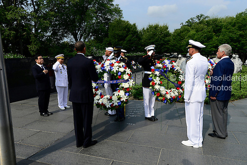 United States President Barack Obama lays a wreath prior to delivering remarks marking the 60th Anniversary of the Korean War Armistice at the Korean War Veterans Memorial in Washington, D.C. on Saturday, July 27, 2013.<br /> Credit: Ron Sachs / Pool via CNP