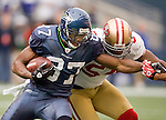 Seattle Seahawks wide receiver Ben Obomanu is tackled by San Francisco 49ers  linebacker LArry Grant at  CenturyLink Field in Seattle, Washington on December 24, 2011.  The 49ers came from behind to beat the Seahawks 19-17. ©2011 Jim Bryant Photo. All Rights Reserved.