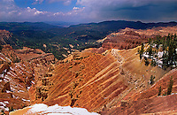 732700008 panoramic view from overlook into sandstone formations and remote tree covered valley with storm clouds overhead in cedar breaks national monument utah