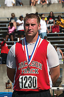 Jackson senior Clay Darnell stands on the awards podium after his third place finish in the Class 4 Discus at the 2014 MSHSAA Class 3-4 State Track and Field Championships, Saturday, May 31, in Jefferson City, MO. Darnell had a best throw of 177-03 to give the Indians six team points.